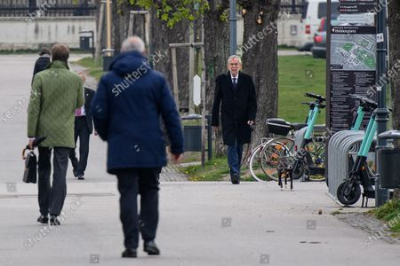 Austrian President Alexander Van der Bellen (R) walks his dog during a government meeting at the Austrian Chancellery in Vienna, Austria, 19 April 2021.