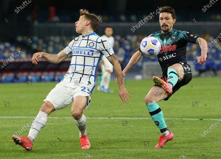 Napoli's Portuguese defender Mario Rui fights for the ball with Inter Milan's Italian midfielder Nicolo Barella