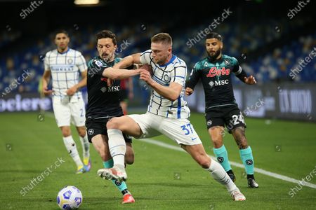 Inter Milan's Slovak defender Milan Skriniar fights for the ball with Napoli's Portuguese defender Mario Rui