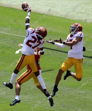 LOS ANGELES, CA - APRIL 17, 2021 - - #27 Quincy Jountti and #7 Stephen Carr try to intercept a pass intended for #13 Michael Jackson III during USC's Spring Football Game in the Coliseum on April 17, 2021. Hundreds of spectators were allowed to attend. This was the first time fans have attended a USC football game of any sort since the pandemic began. (Genaro Molina / Los Angeles Times)