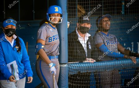 Outfielder Maya Brady gets ready to bat next to head coach Kelly Inouye-Perez during the game against Oregon State at UCLA on April 16, 2021 in Westwood, California. Niece of famed quarterback Tom Brady, Maya iso considered the stand-out athlete of the family and was named Softball America Freshman of the Year after last season's pandemic-shortened season.(Gina Ferazzi / Los Angeles Times)