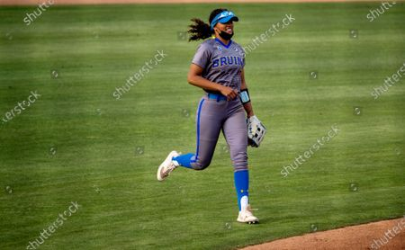 Stock Picture of Outfielder Maya Brady runs in from center field during the game against Oregon State at UCLA on April 16, 2021 in Westwood, California. Niece of famed quarterback Tom Brady, Maya iso considered the stand-out athlete of the family and was named Softball America Freshman of the Year after last season's pandemic-shortened season.(Gina Ferazzi / Los Angeles Times)