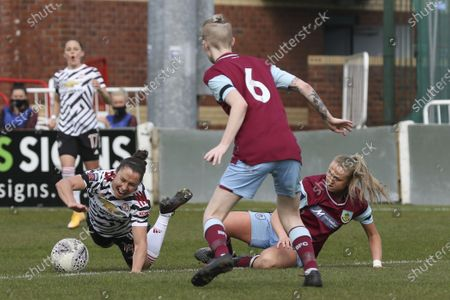 Stock Photo of Jane Goldman (19 Manchester United) being fouled during the Womens FA Cup fourth round match between Burnley and Manchester United at the Lancashire FA Ground, United Kingdom