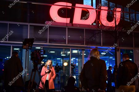 Journalists, amongst them head of the ARD TV Station capital studio Tina Hassel (2-L), wait outside the Konrad-Adenauer-Haus, the Christian Democrats headquarters, during an extraordinary chair board meeting of the Christian Democratic Union (CDU) in Berlin, Germany, 19 April 2021. CDU and CSU sister parties are trying to find a candidate for chancellorship. The choice is to be made between Christian Democratic Union (CDU) party chairman Armin Laschet and State Premier of Bavaria and Christian Social Union (CSU) chairman Markus Soeder.