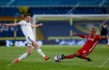 Leeds United defender Luke Ayling (2) and Liverpool midfielder Thiago Alcantara (6) challenge in the middle of the park during the Premier League match between Leeds United and Liverpool at Elland Road, Leeds