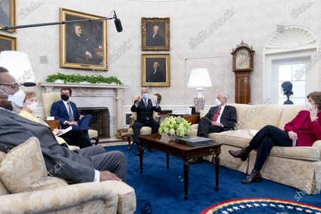 President Joe Biden meets with, from left, Rep. Emanuel Cleaver, D-Mo., Rep. Kay Granger, R-Texas, Transportation Secretary Pete Buttigieg, Sen. Angus King, I-Maine, Sen. Jeanne Shaheen, D-N.H., and other members of congress to discuss his jobs plan in the Oval Office of the White House in Washington