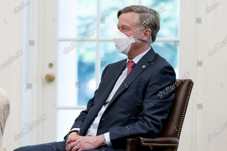 Sen. John Hickenlooper, D-Colo. attends a meeting with President Joe Biden and other members of congress to discuss his jobs plan in the Oval Office of the White House in Washington