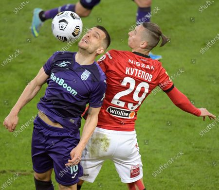 Ufa player Komnen Andric (left) and Spartak player Ilya Kutepov (right) during a match.