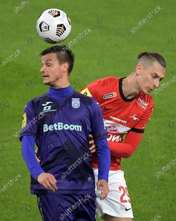 Stock Picture of Ufa player Bojan Jokic (left) and Spartak player Ilya Kutepov (right) during a match.