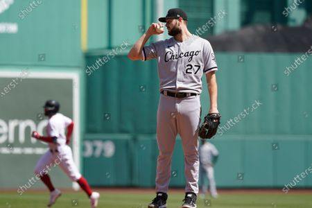 Stock Picture of Chicago White Sox starting pitcher Lucas Giolito reacts after giving up a solo home run to Boston Red Sox's Enrique Hernandez, left, in the first inning of a baseball game at Fenway Park, in Boston