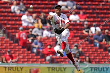 Boston Red Sox third baseman Rafael Devers throws but is too late to get Chicago White Sox's Leury Garcia at first base for a single in the seventh inning of a baseball game at Fenway Park, in Boston