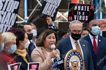 "U.S. Rep. Grace Meng, D-N.Y., center, is joined by Senate Majority Leader Chuck Schumer D-N.Y., at a news conference to discuss an Asian-American hate crime bill, in New York. ""For more than a year, the Asian American community has been fighting two crises - the COVID-19 pandemic and the anti-Asian hate,"" said Meng"