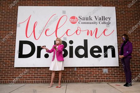 First lady Jill Biden, arrives for a visit to Sauk Valley Community College, in Dixon, Ill., as Rep. Cheri Bustos, D-Ill., right, watches