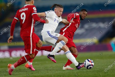 Leeds United's Kalvin Phillips, center, is challenged by Liverpool's Georginio Wijnaldum, riught, during the English Premier League soccer match between Leeds United and Liverpool at the Elland Road stadium in Leeds, England