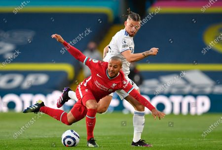 Liverpool's Thiago Alcantara (L) is tackled by Leeds United's Kalvin Phillips (R) during the English Premier League soccer match between Leeds United and Liverpool FC in Leeds, Britain, 19 April 2021.