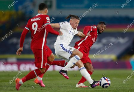 Leeds United's Kalvin Phillips (C) in action between Liverpool's Roberto Firmino (L) and Liverpool's Georginio Wijnaldum (R) during the English Premier League soccer match between Leeds United and Liverpool FC in Leeds, Britain, 19 April 2021.