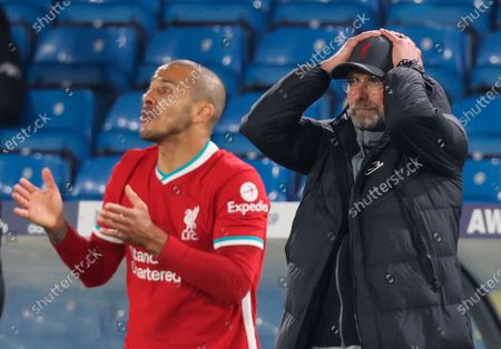 Liverpool's head coach Juergen Klopp (R) reacts as Liverpool's Thiago Alcantara (L) gestures during the English Premier League soccer match between Leeds United and Liverpool FC in Leeds, Britain, 19 April 2021.