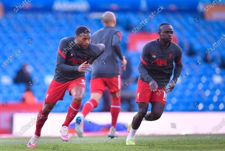Liverpool's Georginio Wijnaldum (L) and Liverpool's Sadio Mane (R) warm up before the English Premier League soccer match between Leeds United and Liverpool FC in Leeds, Britain, 19 April 2021.