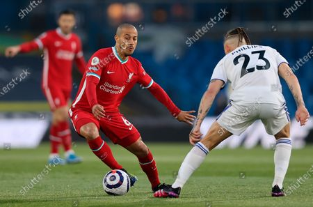 Liverpool's Thiago Alcantara (L) in action with Leeds United's Kalvin Phillips (R) during the English Premier League soccer match between Leeds United and Liverpool FC in Leeds, Britain, 19 April 2021.