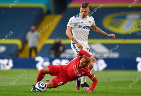 Liverpool's Thiago Alcantara (down) is tackled by Leeds United's Kalvin Phillips (R) during the English Premier League soccer match between Leeds United and Liverpool FC in Leeds, Britain, 19 April 2021.