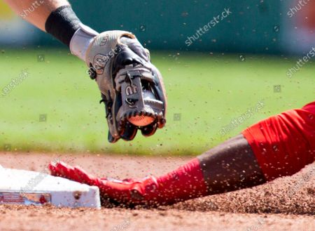 Stock Image of Chicago White Sox second baseman Nick Madrigal (L) is unable to put the tag on Boston Red Sox's Marwin Gonzalez (R) during the first inning at Fenway Park in Boston, Massachusetts, USA, 19 April 2021. The Boston Red Sox kept in tradition with holding the only morning baseball game of the entire MLB on the day the Boston Marathon was to be traditionally run, Patriots Day, a holiday in Massachusetts and Maine, despite the marathon being postponed to 11 October 2021.