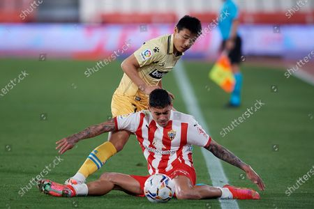 Samu Costa of Almeria and Wu Lei of Espanyol compete for the ball during the La Liga Smartbank match between UD Almeria and RCD Espanyol de Barcelona on April 19, 2021 at Estadio de los Juegos Mediterrraneos in Almeria, Spain. Sporting stadiums around Spain remain under strict restrictions due to the Coronavirus Pandemicwaving to fansGovernment social distancing laws prohibit fans inside venues resulting in games being played behind closed doors.