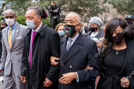 Rev. Al Sharpton, center right, walks with Rev. Jesse Jackson, second from left, after leaving a news conference outside the Hennepin County Government Center before the murder trial against the former Minneapolis police officer Derek Chauvin in the killing of George Floyd advances to jury deliberations, in Minneapolis