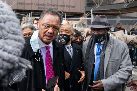 Rev. Jesse Jackson takes a question from a reporter alongside Rev. Al Sharpton, center, and attorney Ben Crump, right, after a news conference outside the Hennepin County Government Center before the murder trial against the former Minneapolis police officer Derek Chauvin in the killing of George Floyd advances to jury deliberations, in Minneapolis