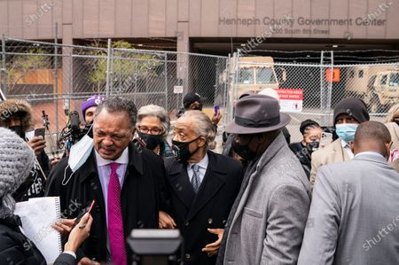 Rev. Jesse Jackson takes a question from a reporter alongside Rev. Al Sharpton, center, after a news conference outside the Hennepin County Government Center before the murder trial against the former Minneapolis police officer Derek Chauvin in the killing of George Floyd advances to jury deliberations, in Minneapolis