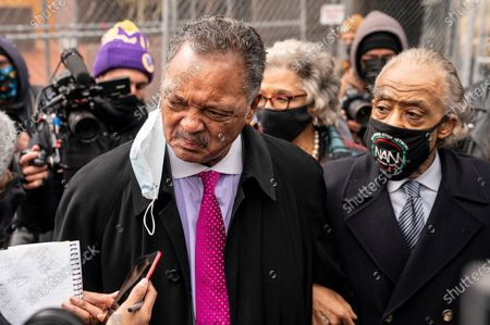 Reverend Jesse Jackson takes a question from a reporter alongside Rev. Al Sharpton, right, after a news conference outside the Hennepin County Government Center before the murder trial against the former Minneapolis police officer Derek Chauvin in the killing of George Floyd advances to jury deliberations, in Minneapolis