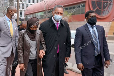 Rep. Ilhan Omar, D-Minn., center left, holds hands with Rev. Jesse Jackson outside the Hennepin County Government Center in Minneapolis, before the murder trial against former Minneapolis police officer Derek Chauvin advances to jury deliberations