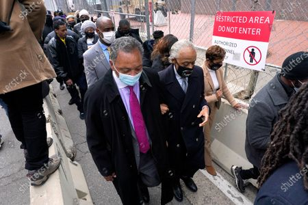 Reverend Jesse Jackson, left, interlocks arms with Rev. Al Sharpton as they walk back to the Hennepin County Government Center in Minneapolis, before the murder trial against former Minneapolis police officer Derek Chauvin advances to jury deliberations