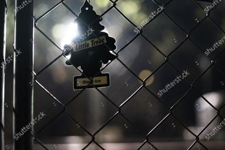 An air freshener hangs on the fencing outside of the Brooklyn Center Police Department on April 17, 2020. Protests continued for the seventh consectutive night outside the Brooklyn Center Police Department after former officer Kim Porter killed 20-year-old Daunte Wright in a traffic stop.