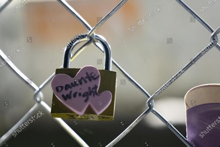 Stock Picture of A padlock with Daunte Wright's name on it hangs on fencing outside of the Brooklyn Center Police Department on April 17, 2020. Protests continued for the seventh consectutive night outside the Brooklyn Center Police Department after former officer Kim Porter killed 20-year-old Daunte Wright in a traffic stop.