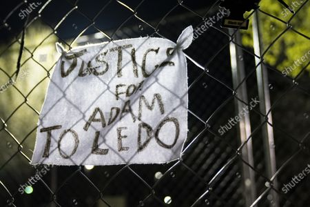 "A sign that reads ""JUSTICE FOR ADAM TOLEDO"" hangs on fencing outside of the Brooklyn Center Police Department on April 17, 2020. Protests continued for the seventh consectutive night outside the Brooklyn Center Police Department after former officer Kim Porter killed 20-year-old Daunte Wright in a traffic stop."