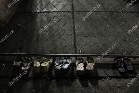 A row of shoes lie on the ground behind fencing outside of the Brooklyn Center Police Department on April 17, 2020. Protests continued for the seventh consectutive night outside the Brooklyn Center Police Department after former officer Kim Porter killed 20-year-old Daunte Wright in a traffic stop.