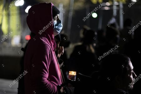A person holds a candle outside of the Brooklyn Center Police Department on April 17, 2020. Protests continued for the seventh consectutive night outside the Brooklyn Center Police Department after former officer Kim Porter killed 20-year-old Daunte Wright in a traffic stop.