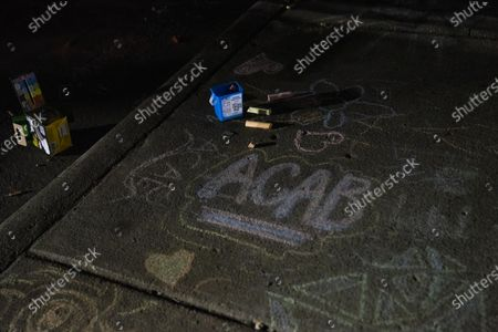 "Chalk spells out ""ACAB"" on the sidewalk outside of the Brooklyn Center Police Department on April 17, 2020. Protests continued for the seventh consectutive night outside the Brooklyn Center Police Department after former officer Kim Porter killed 20-year-old Daunte Wright in a traffic stop."