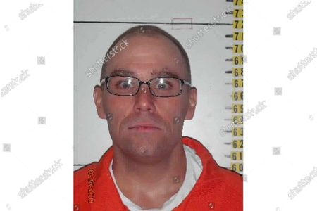 From the Nevada Department of Corrections shows Zane Michael Floyd, a Nevada death row inmate convicted of killing four people and wounding a fifth in a shotgun attack at a Las Vegas supermarket in 1999. Floyd who is fighting an early June execution date that would make him the first person put to death in Nevada since 2006 has filed court documents calling for the state to consider firing squad as an option