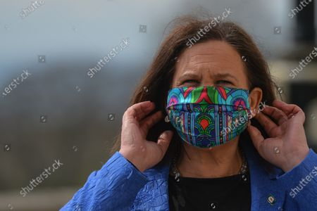 Sinn Fein leader Mary Lou McDonald put a face mask following the media briefing outside Stormont in Belfast. On Monday, April 19, 2021, in Belfast, Northern Ireland