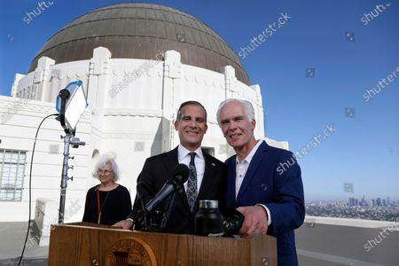 Stock Image of Los Angeles Mayor Eric Garcetti, center, shown with his father, Gil Garcetti, former Los Angeles County's 40th district attorney, and mother, Sukey Garcetti, left, pose before the mayor holds his annual State of the City address from the Griffith Observatory, in Los Angeles