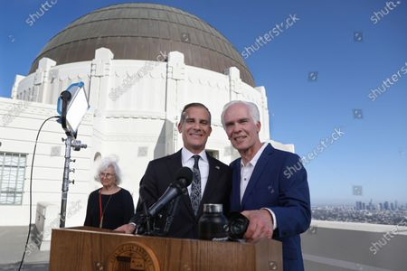 Stock Photo of Los Angeles Mayor Eric Garcetti (C) with father Gil Garcetti, former Los Angeles County's 40th district attorney, and mother Sukey Garcetti, poses for the photographer before holding his annual State of the City address from the Griffith Observatory in Los Angeles, CA, USA, 19 April 2021.