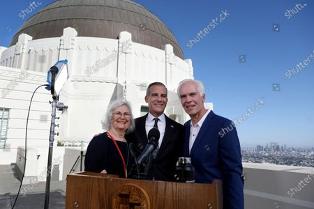 Stock Picture of Los Angeles Mayor Eric Garcetti (C) with father Gil Garcetti, former Los Angeles County's 40th district attorney, and mother Sukey Garcetti, poses for the photographer before holding his annual State of the City address from the Griffith Observatory in Los Angeles, CA, USA, 19 April 2021.