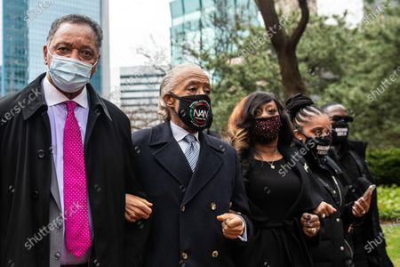 Stock Image of Reverend Jesse Jackson, Reverend Al Sharpton and Tamika Mallory walk with locked arms after a press conference outside the Hennepin County Government Center on April 19, 2021, the day of closing arguments and the beginning of jury deliberation in the Derek Chauvin Trial in Minneapolis, Minnesota
