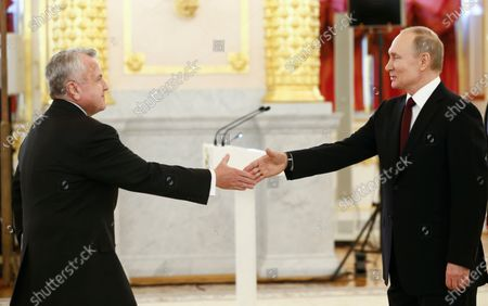 Taken, Russian President Vladimir Putin, right, and the new U.S. Ambassador to Russia John Sullivan shake hands during a ceremony to receive credentials from newly appointed foreign ambassadors to Russia in Kremlin, in Moscow, Russia. Sullivan said he was heading home for consultations and would return to Moscow in the nearest weeks