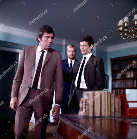 Jeff Randall, as played by Mike Pratt, is captured by Hooper, as played by Peter Jesson, and Grant, as played by Robin Hawdon