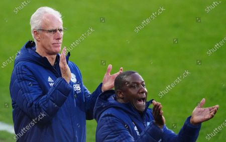 Mick McCarthy Manager of Cardiff City reacts with assistant manager Terry Connor