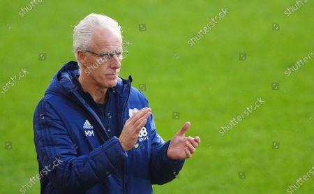 Mick McCarthy Manager of Cardiff City  clapping his team