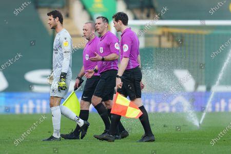 Referee Tim Robinson talks to Watford Goalkeeper Daniel Bachmann (26)