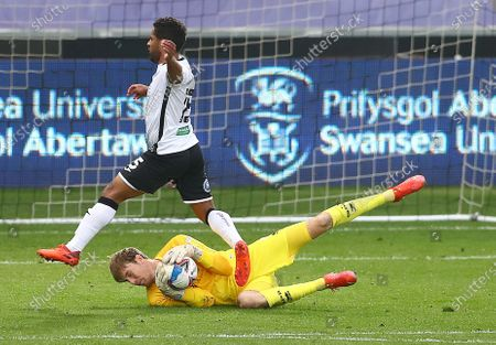 Stock Picture of QPR Goalkeeper Joe Lumley saves from Wayne Routledge of Swansea City